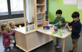 Children experimenting with laboratory equipment